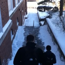 Students walk to class after campus is blanketed in snow. Photo by Michelle DePinho.