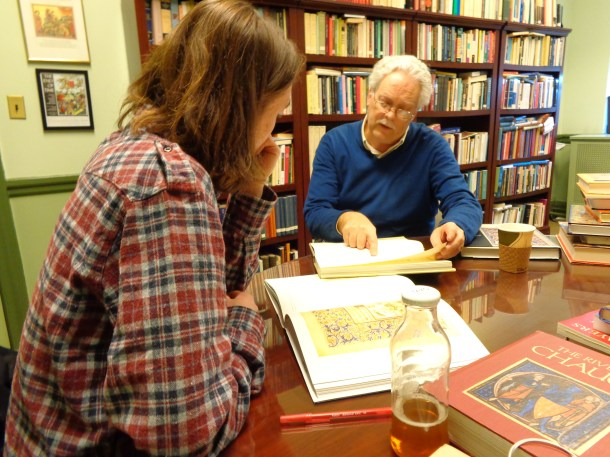 Emmerson showing Coyne a medieval manuscript during his independent study.