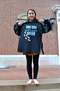 Freshman Natalie Craig proudly displays a t-shirt she received for a participating in the event. Photo by Kyleigh Panetta.