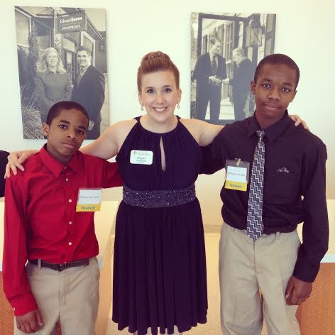Megan McShane with two students at the De La Salle Gala in St. Louis. Photo Courtesy of Megan McShane.