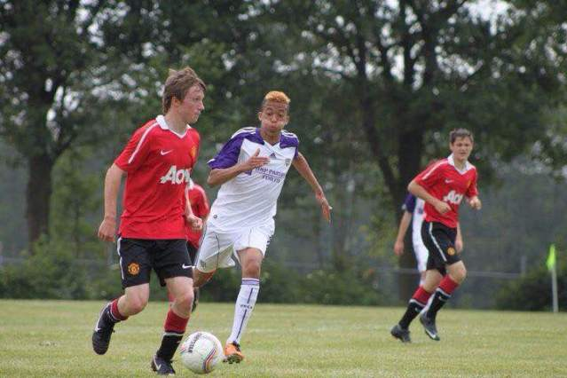 As part of the Manchester United Academy, Ryan Shields possesses the ball with ease while warding off defenders. Photo courtesy of Ryan Shields.