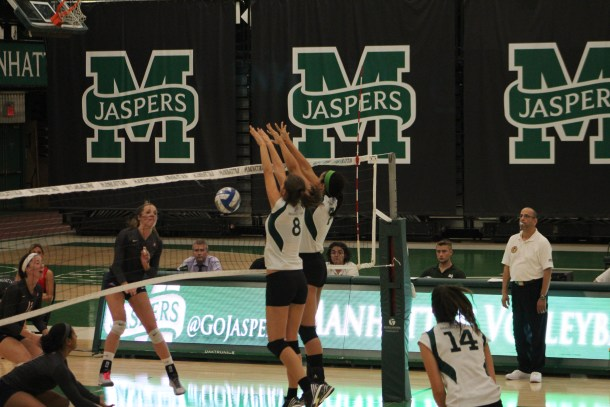 Ivana Kostic and Casey Monroe team up for a block, one of eight for the Jaspers on the night. Photo by Vanessa Sanchez.
