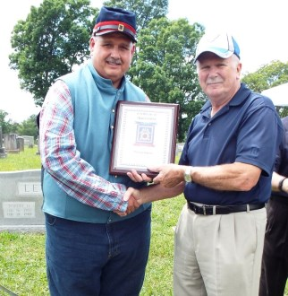 JVC Homes presents plaque to William Busser