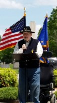McReynolds speaking at memorial service