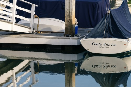 Picture of nautical boat reflections from Balboa Island on Newport Bay, Newport Beach, California, USA.