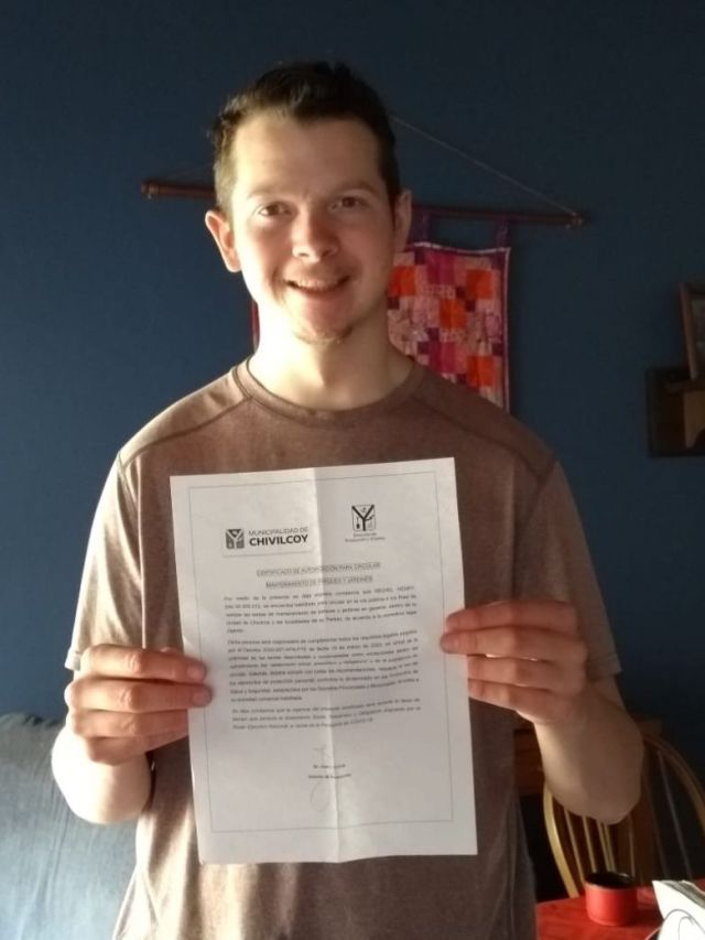 Thrilled to get his paperwork for working at the camp