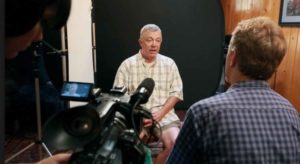 filming an interview for a settlement documentary