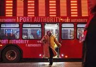 woman getting off PAT bus (Steve Mellon/Post-Gazette)