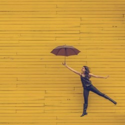 woman with umbrella happiness and optimism