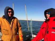 Captain Ralph Tarr and Linda Allen discuss the day's progress.
