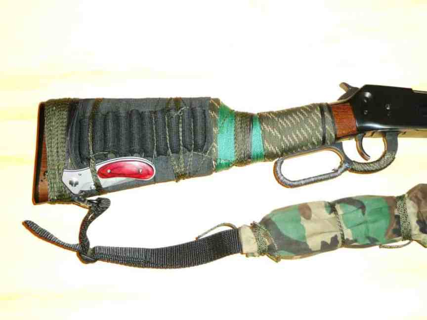 lock bladed knife attached to rifle stock