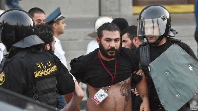 Armenia -- Photojournalist Karo Sahakian dragged by police, Yerevan, 23Jun2015