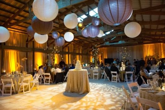 Uplights, lanterns and pinspots at a barn wedding