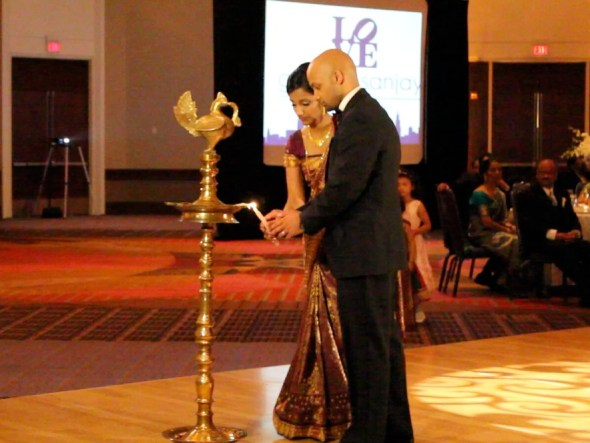 Gisha and Sanjay lighting the Unity Candle