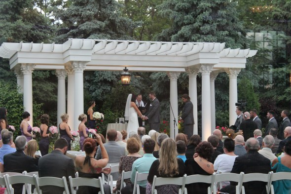 "Nicole and Jared saying ""I Do"" at the Patrick C Haley Mansion"