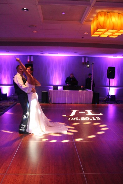 Jennifer and Loren dancing on their personal Gobo at the Holiday Inn Mart Plaza Wedding