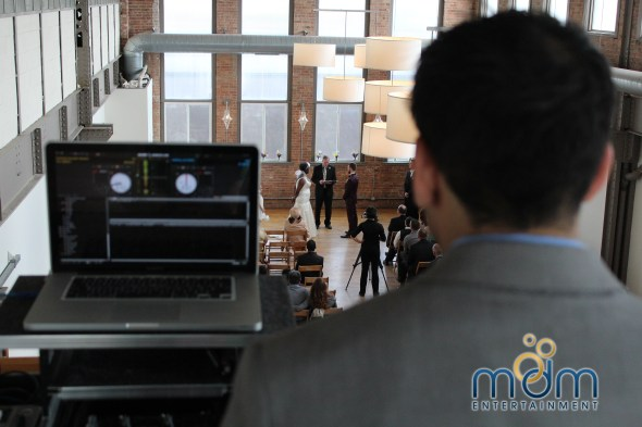 MDM DJ Aumir Walking down the aisle at Kitchen Chicago and city view loft wedding ceremony
