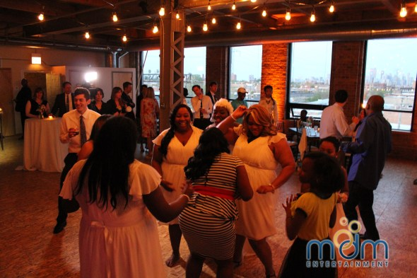 Bridesmaids on the dance floor at Kitchen Chicago and City View Lofts Wedding