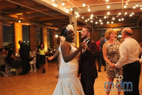 Couple Dancing at Kitchen Chicago and City View Loft Wedding