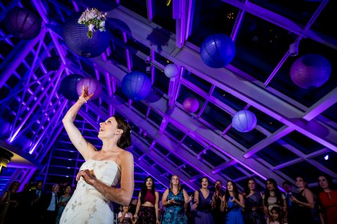 Bouquet Toss at And Adler Planetarium Wedding