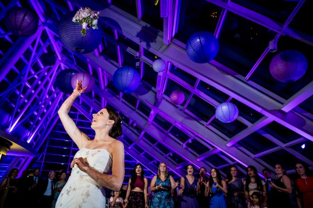 Bouquet Toss at And Adler Planetarium Wedding