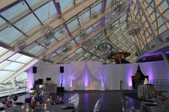 Drape wall and silver pendant chandeliers at Adler Planetarium
