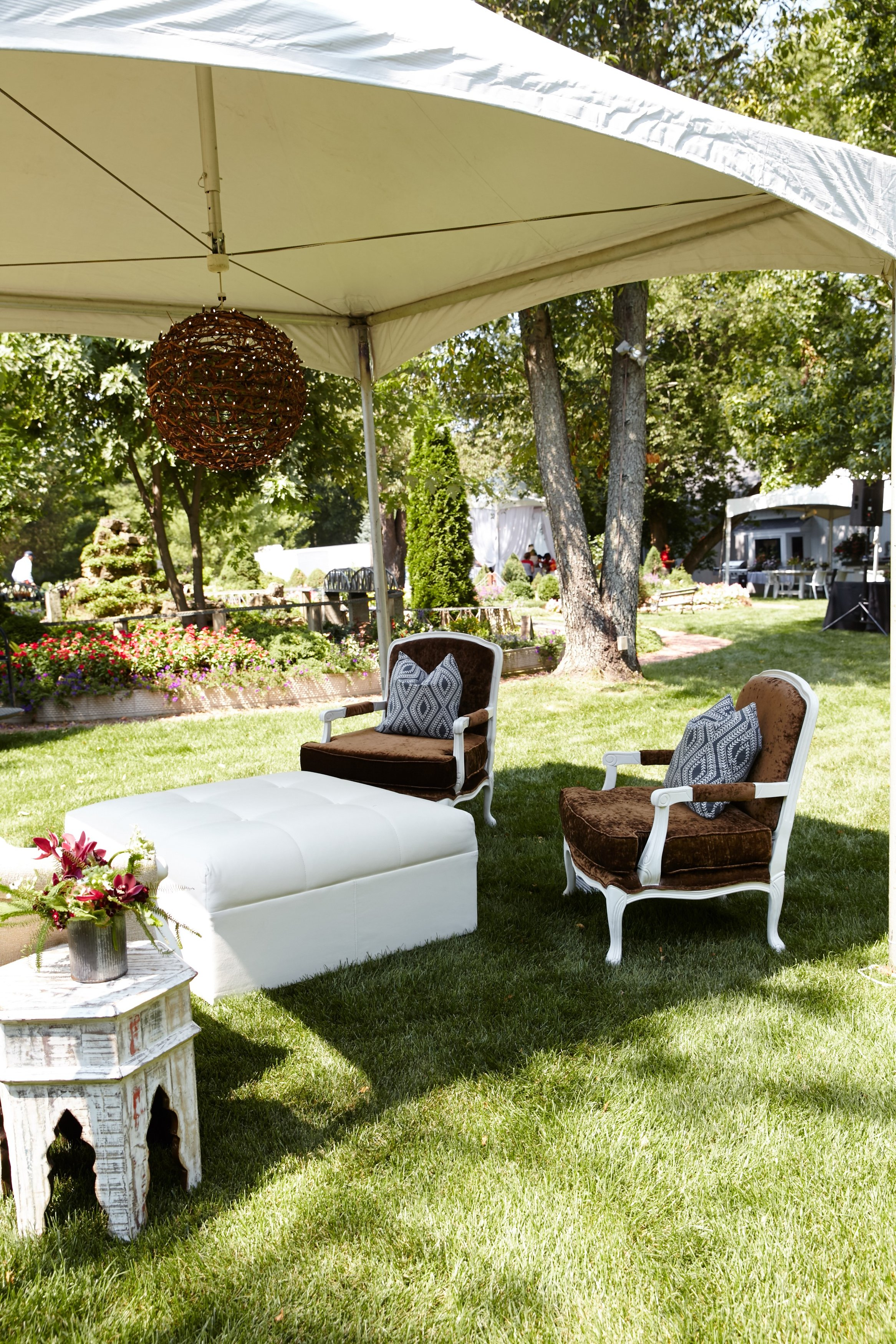 grapevine ball chandeliers and a lounge set for a rustic chic tent