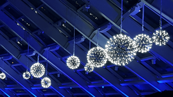 Silver Pendant Chandeliers with Blue Uplighting
