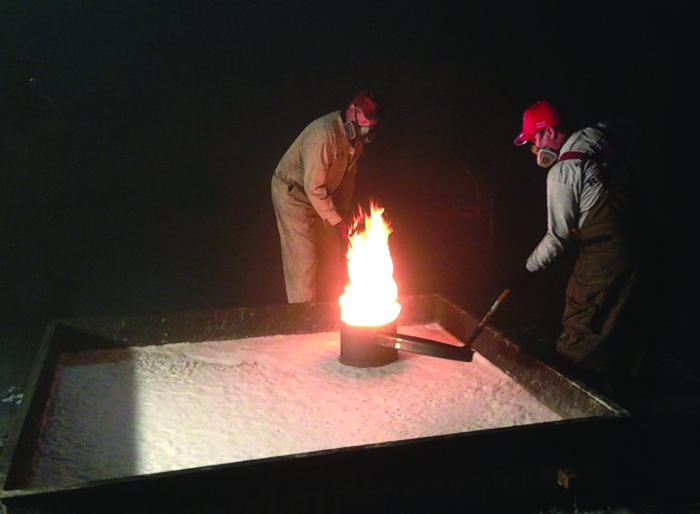 Technicians conduct a foam burn-back test