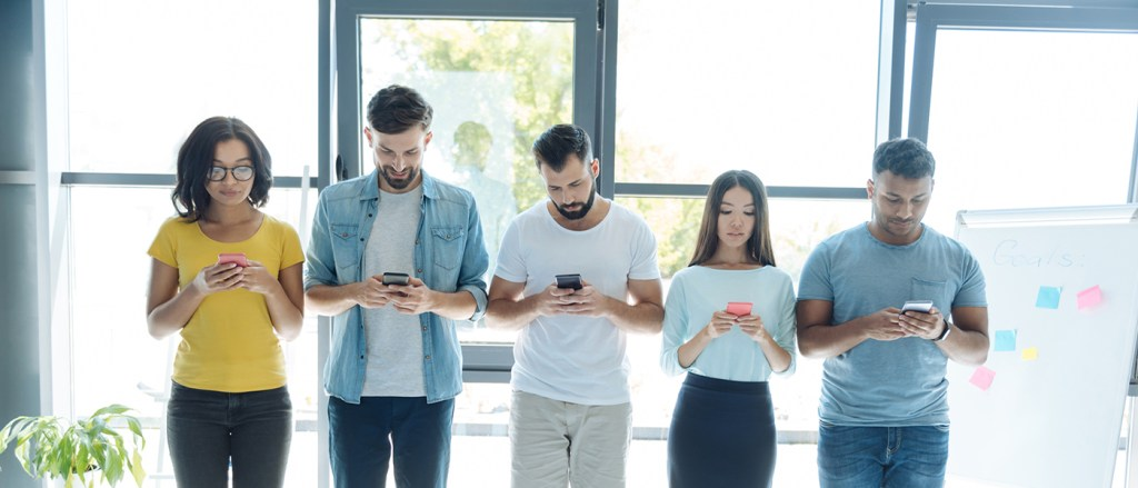 Group of people using digital devices