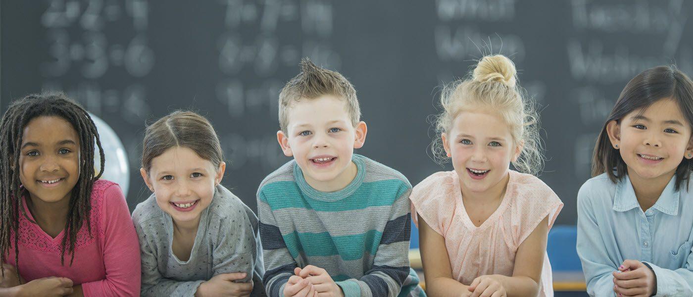group of smiling school children