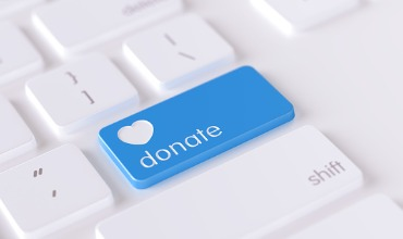 modern-keyboard-button-with-donation-icon-charity-concept-picture-id1223061872