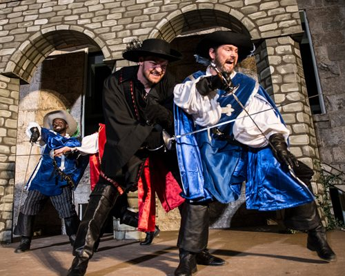 The King's Musketeers battle the Cardinal's men. From left to right: Aramis (Gerrad Alex Taylor), Rochefort (Willem Krumich) and Athos (Kevin Alan Brown.) Photo by Teresa Castracane.