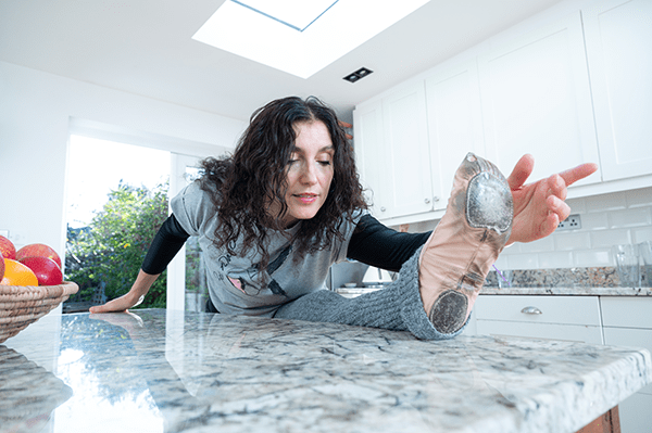 Michela stretches on her kitchen island with ballet point shoes