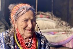 Kalasha woman wearing beaded necklace.