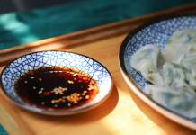 round blue saucer filled with soy sauce