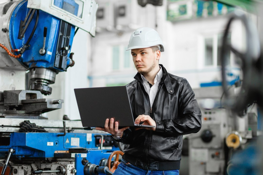 young engineer with laptop in hands