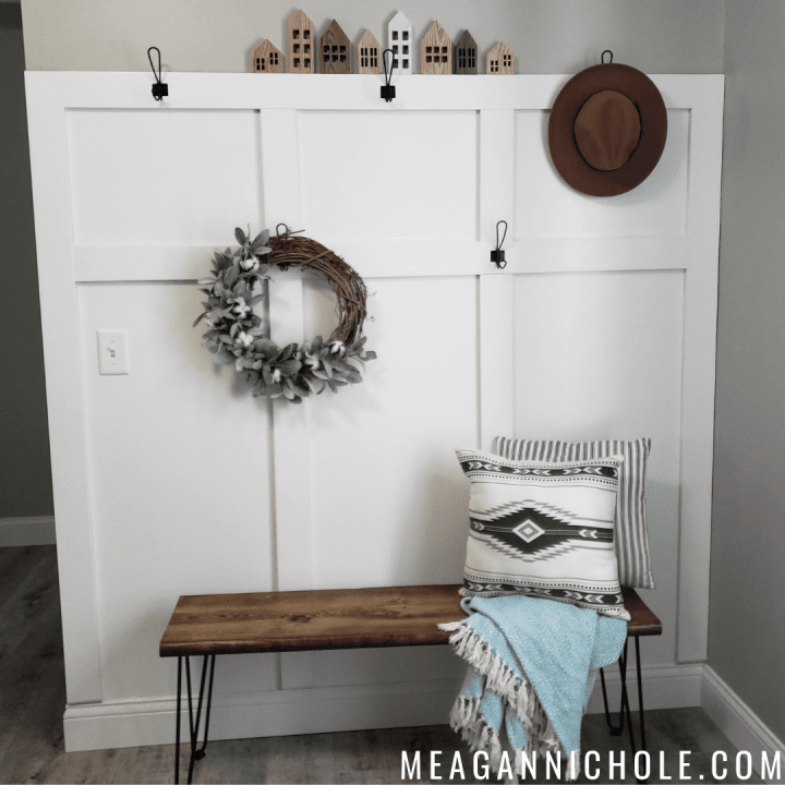 white board and batten wall with hooks and wooden bench