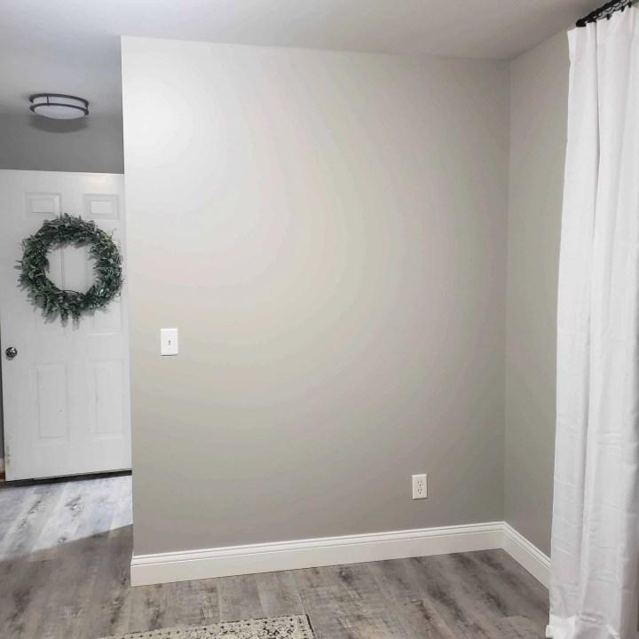 gray wall and gray flooring