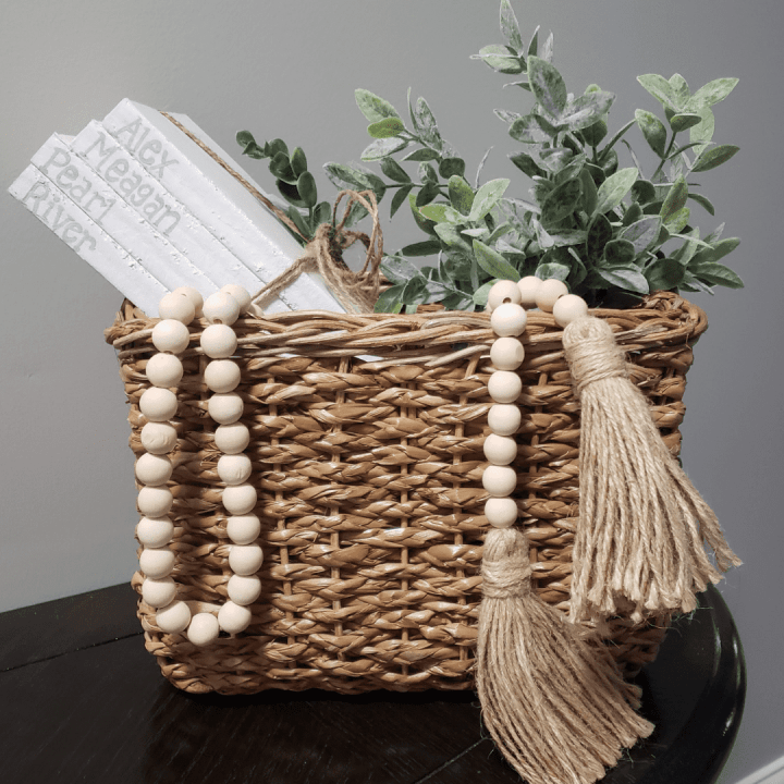 a photo of books in a basket with a plant for a DIY Mother's Day Gifts blog post