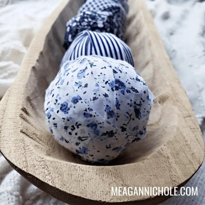 navy Rag Balls in wooden bowl