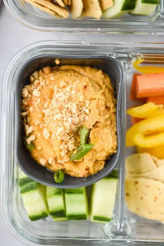 Thai peanut hummus close up in meal prep container