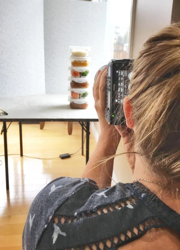 steph taking photos of food prep containers