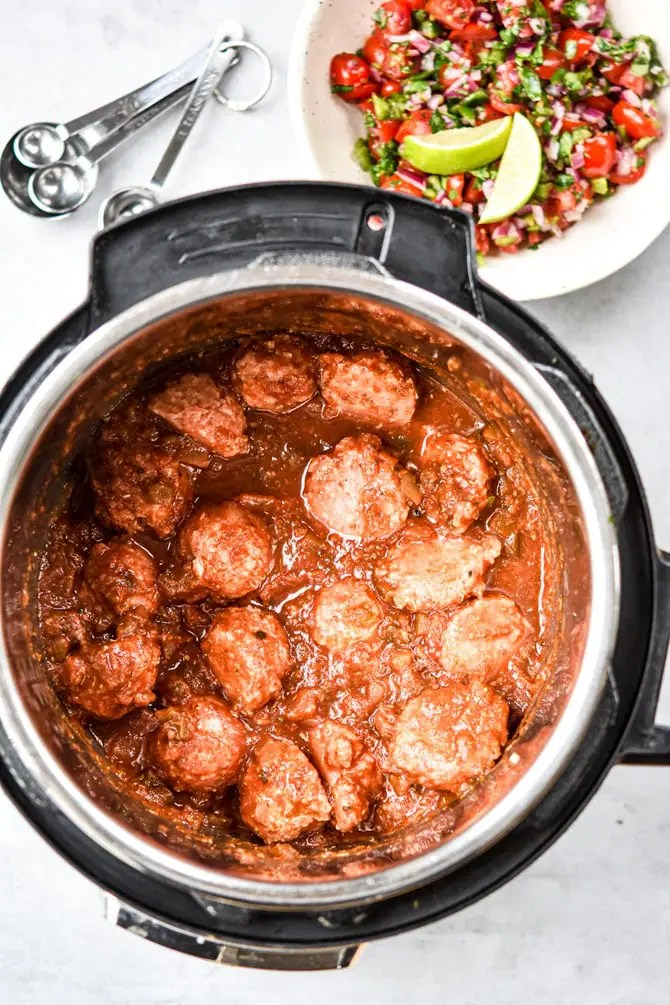 Instant Pot Mexican Meatballs in pot before cooking