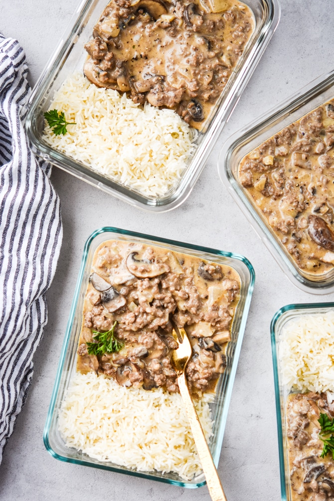 ground beef stroganoff in containers with fork in container