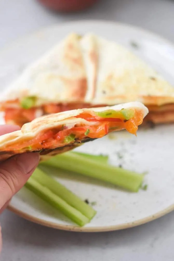 veggie quesadilla cut open to show melted cheese