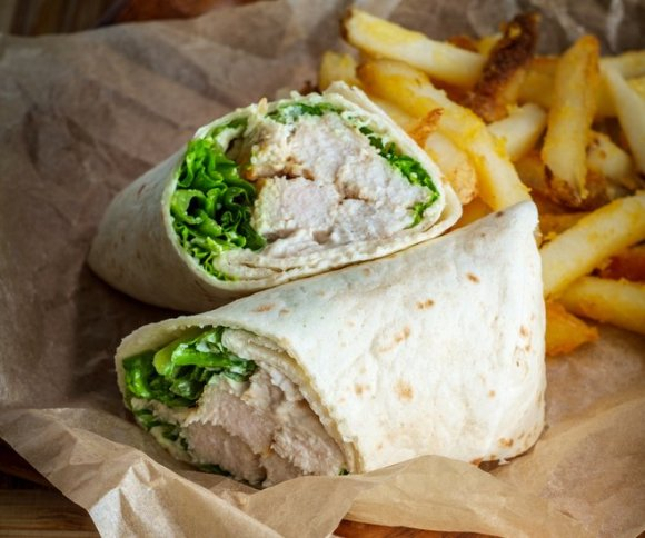 This chicken caesar wrap is just one of 20+ leftover chicken ideas you can use to fill your weekly meal plan, save you money and reduce waste.