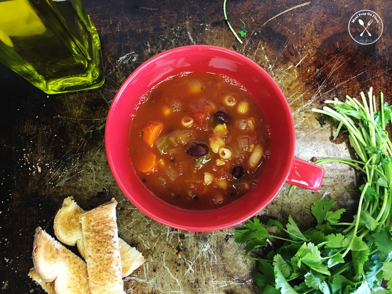 minestrone soup in a red cup