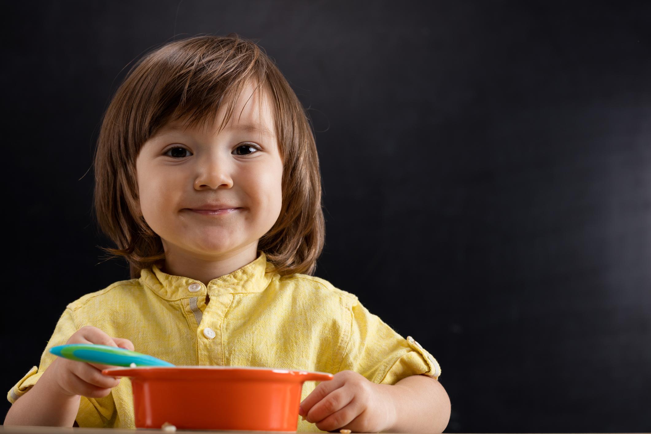 happy kid eating food