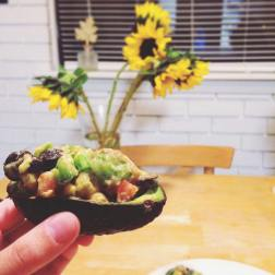 Yummy stuffed avocado! Lovely sunflowers, courtesy of Eric (they aren't growing from the avocado).